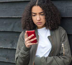 A girl checks her cellphone