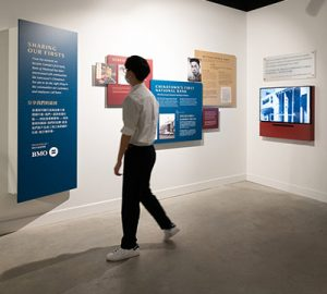 A man looking at the Vancouver Chinatown Foundation display