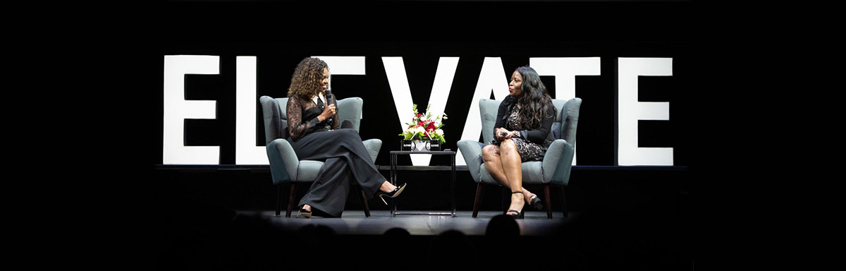 Michelle Obama speaks with Claudette McGowan