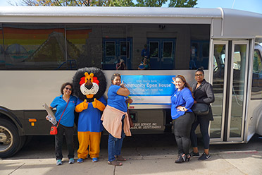 Hubert the Lion, the mascot for BMO Harris Bank, attends a Community Open House with bank employees