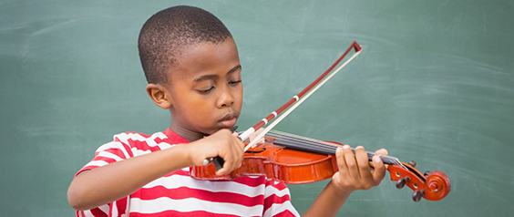 A little boy playing the violin